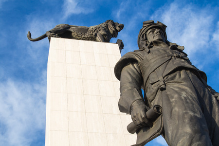 stefanik: Statues of a lion as a symbol of Czechoslovakia and Milan Rastislav Stefanik as an important politician. Blue sky with intense contrast clouds. Editorial
