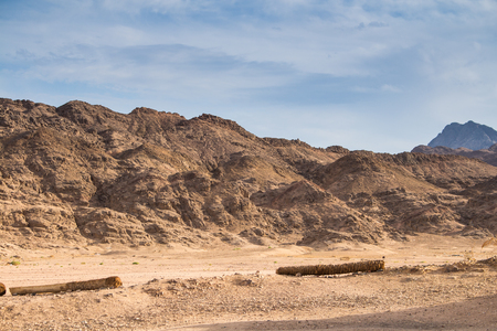 rounded edges: Rounded edges of the mountains in egyptian desert. Cloudy sky.