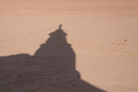 hurghada: Shadow of the tower of a small bedouin mosque in the desert close to Hurghada in Egypt.
