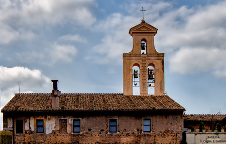 to incorporate: The basilica of Santi Cosma e Damiano is a church in the Roman Forum,parts of which incorporate original Roman buildings. Tower of belfry and cloudy sky.