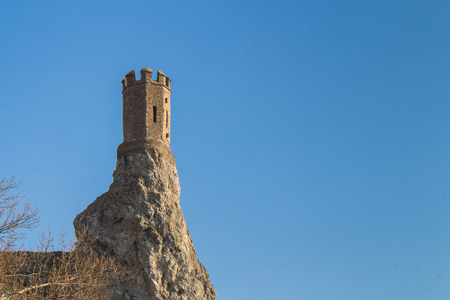 morava: Rocks, where was former fortress with a Maiden Tower, part of ruins of castle Devin in Slovakia. Bright blue sky. Stock Photo