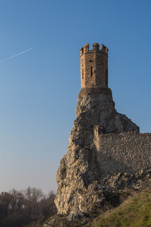 morava: Rocks of the former fortress with a Maiden Tower, part of ruins of castle and fortress Devin in Slovakia. Bright blue sky.