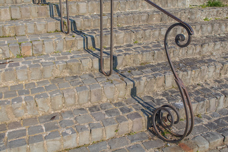 old metal: Stairs made of stone cubes and an iron handle.