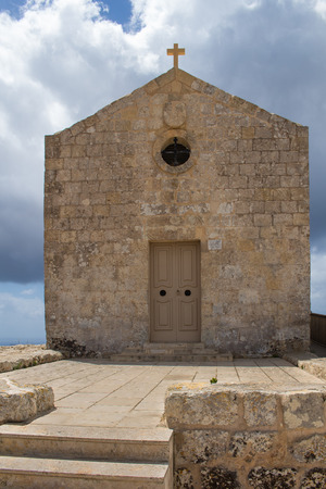 seventeenth: St. Mary Magdalene Chapel was rebuilt on the cliff edge in the seventeenth century. Located in Dingli at the mediterranean island Malta. Intense clouds.