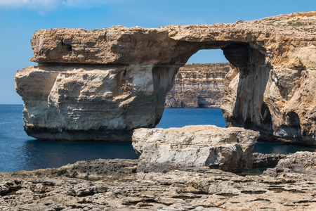 Azure window, the rock formation with a tunel, which is not existing anymore. Calm sea, blue sky. Island Gozo, Malta.