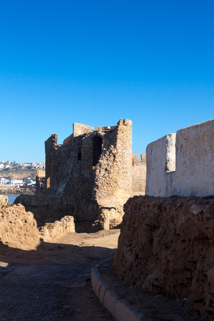 Details of the architecture of the historical portuguese fortress (castle) Dar el Bahar, located at the coastline of Atlantic ocean. Bright blue sky. Safi, Morocco.