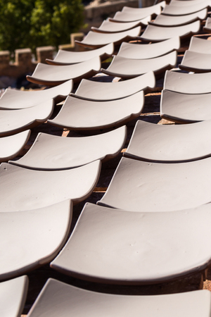 Same ceramic products, stil raw, getting dry on the sun outdoors at the yard of the production. Safi, Morocco. Stock Photo