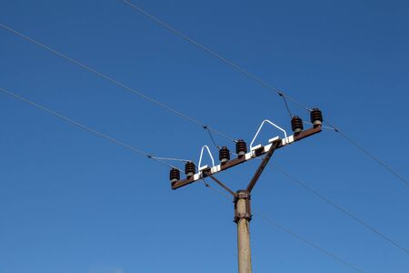 Detail of an electricity column, during a sunny day with a bright clear blue sky. Puste Ulany, Slovakia. 版權商用圖片