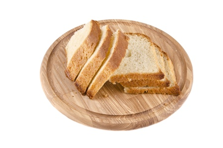 Cutting board with bread on white baclground