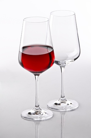Two glasses and one with red wine