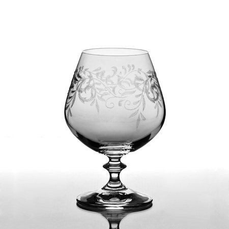 Cognac glass isolated on light background