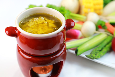 Bagna Cauda  italian warm dip served with fresh vegetables Stock Photo