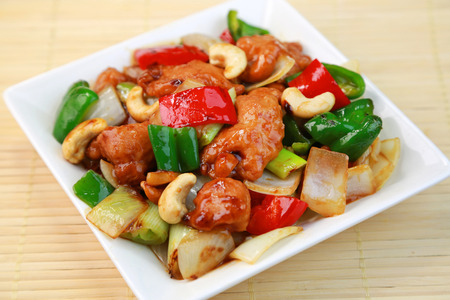 Thai cuisine  Chicken with cashew nuts, vegetables Stock Photo