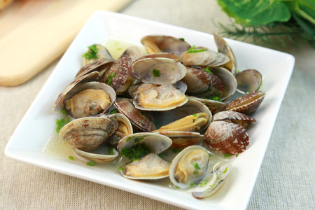 Butter steaming of a short-necked clam photo