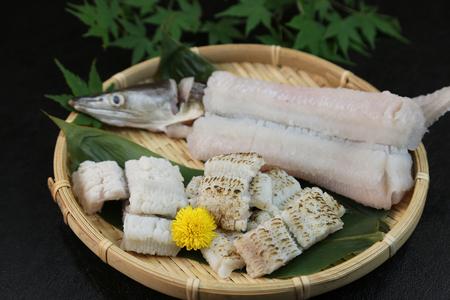 This is called yubiki hamo (parboiled conger pike) or botan hamo (peony-shaped conger pike). Stock Photo
