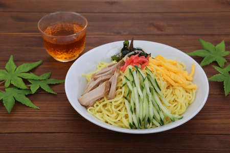 It is one of the noodles dishes which cool the Chinese noodles which I boiled with water and ice, and put ingredients materials on the top. Stock Photo