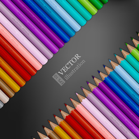 Rows of rainbow colored pencils on dark grey background.