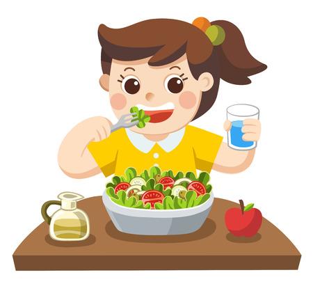 Una niña feliz de comer ensalada. ella ama las verduras.