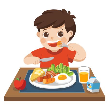 Un petit garçon heureux de prendre son petit déjeuner le matin.