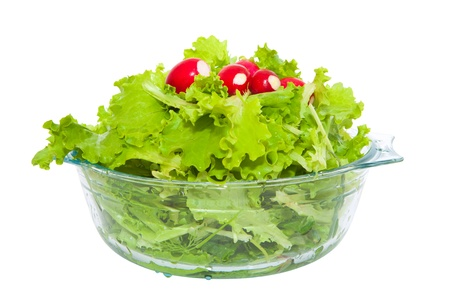 fresh lettuce and radish in a glass bowl on a white background