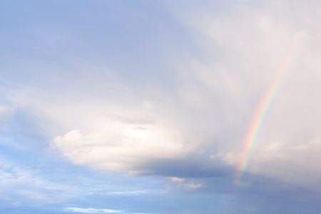 somewhere: beautiful rainbow in a cloudy sky, the weather is clear, summer