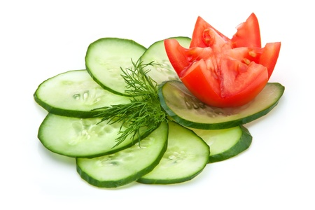 slices of cucumber and a sprig of fresh dill, red tomatoes
