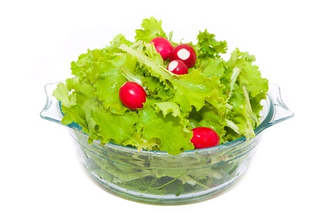 green lettuce and fresh radishes mixed in a glass bowl Banque d'images