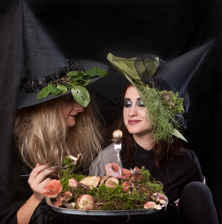 Women make up as witches for Halloween, in the studio photo