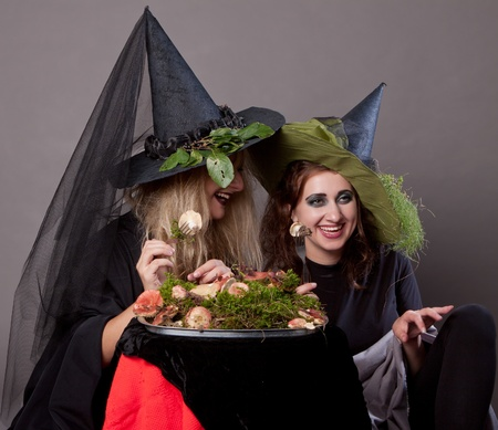 Girls make up as witches, dining mushrooms photo