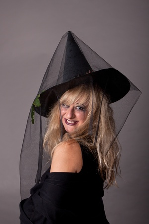 a young woman dressed as a witch, makeup for Halloween  photo