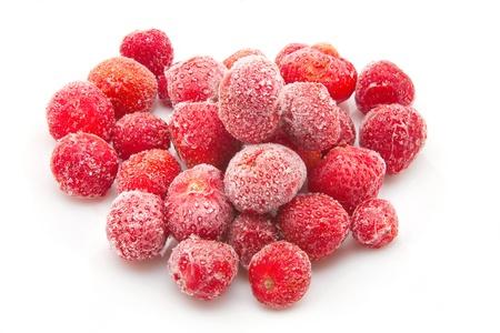 sweet, luscious frozen strawberries isolated on white background photo