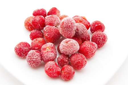 sweet, luscious frozen strawberries isolated on white background Stock Photo