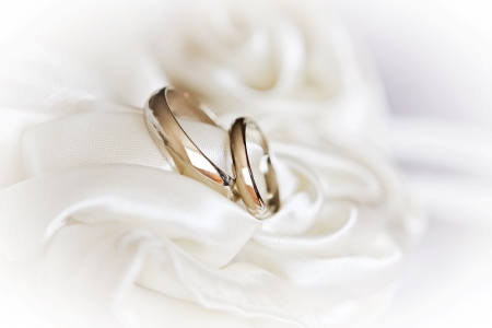 pair of wedding rings on a white fabric, high key Stock Photo - 13646178