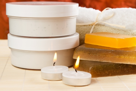 set of objects for spa and body care, such as soaps, towels and moisturizer photo