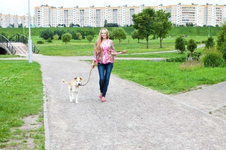 girl walk on the track with her puppy