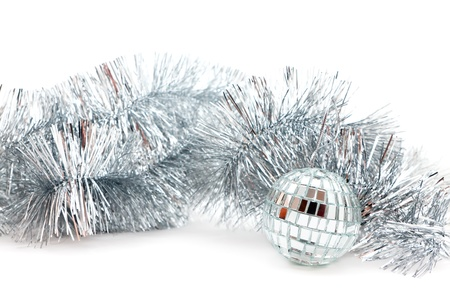 Christmas decorations: a mirror ball and garland Stock Photo - 16138775