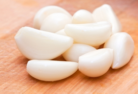 white garlic cloves on a wooden board Stock Photo - 16380026