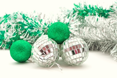 green Christmas balls in bright sequins and garland Stock Photo - 16457549
