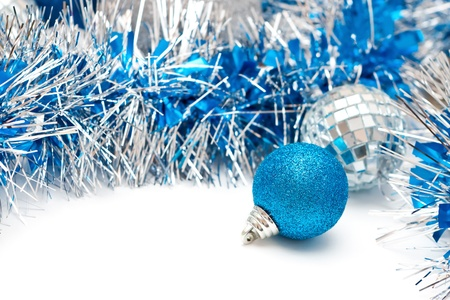 Christmas decoration - blue ball and garland Stock Photo - 16731017