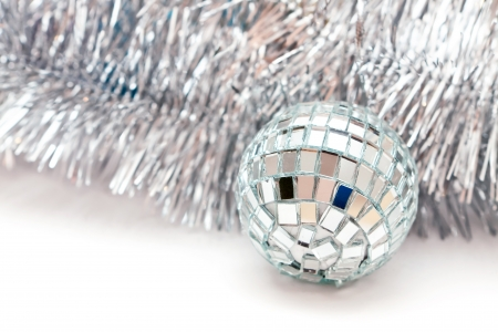 glass Christmas ball and a silver garland Stock Photo - 16882170