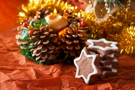 Christmas cookies with chocolate icing on a background of Christmas decorations photo