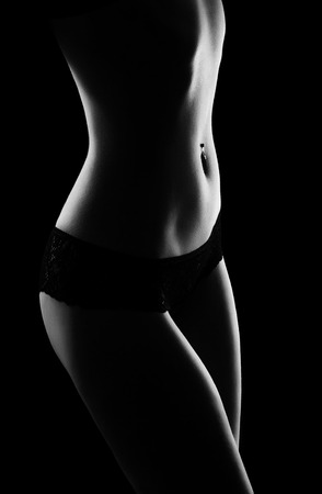 fragment of sensuously curved slender female figure, black-and-white photo photo
