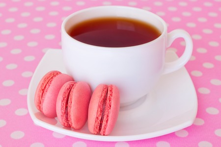 macaroon with fruit filling and a cup of tea - sweet dessert photo