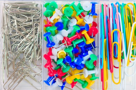 yellow tacks: office supplies in a box, set of stationery, paper clips and buttons stationery Stock Photo