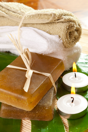 set of body care products, towels and candles Stock Photo