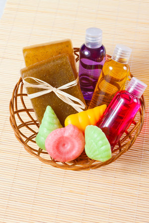 gels: varied handmade soaps and shower gels in a basket Stock Photo