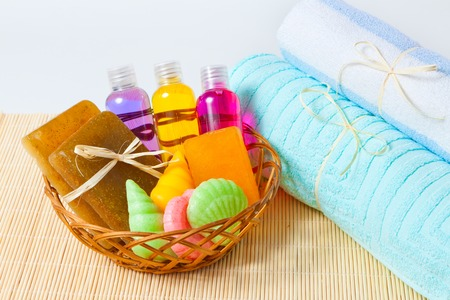 gels: towels, handmade soap and shower gels in a basket Stock Photo