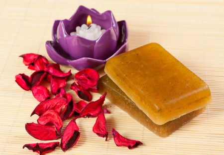 taking bath: soap, candles and petals for taking bath