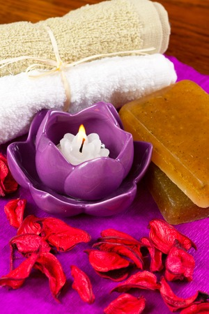 spa attributes: candles, flower petals and other Stock Photo