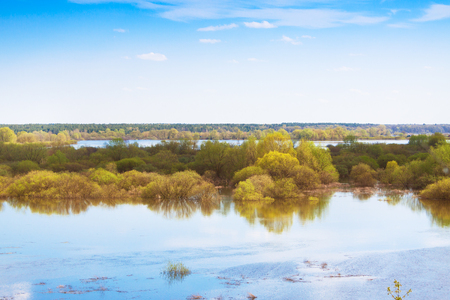 A beautiful spring sky over a flooded meadow, a clear day Stock Photo
